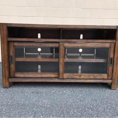 Beautiful wood and sliding glass door television entertainment unit. The dimensions are 30.5