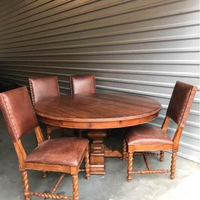 Solid wood round table with 8 chairs, Made by Stanley Furniture. The table comes with 4 leaf panels which make it larger to accommodate...