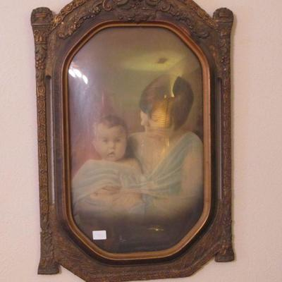 A truly elegant piece. The frame is exquisite with the bubble glass and the lovely woman and child makes this piece irresistible.