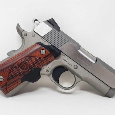 140: Colt Defender .45cal Semi-Auto Pistol with Original Case and Magazine Serial Number: DR65164 Barrel Length: 3
