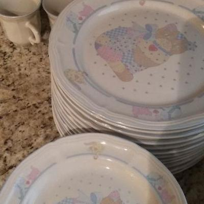 Cute cat pattern service for 12.  Each set includes dinner plates, dessert plates, cups and saucers, and bowls.