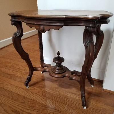 Lot # 5 - $175 Victorian Table with casters (Table is light weight). Caster are very small and white. 2 ft. 8