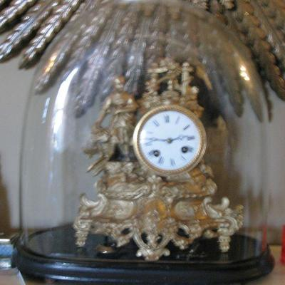 antique oval glass dome with mantle clock