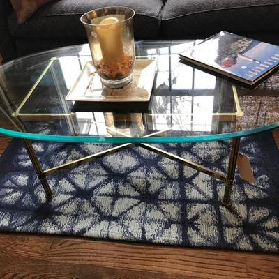 Glass and brass coffee table $175 4' X 26