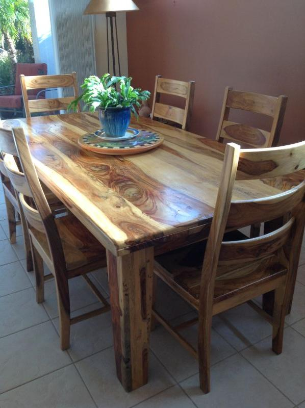 Beautiful solid wood dining table and 6 chairs. Asking $325