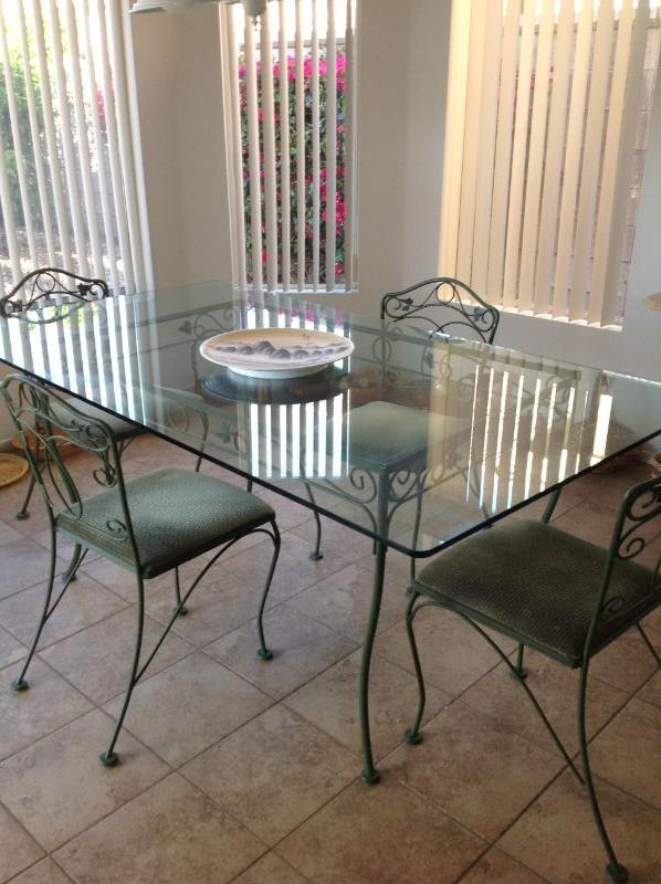 Glass top table and 4 chairs, $75