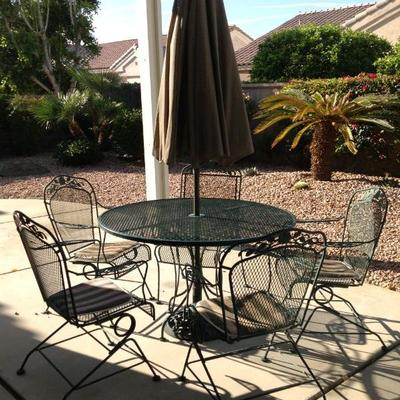 Mesh table, 5 chairs, umbrella and stand, $125