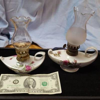 2 small oil lamps