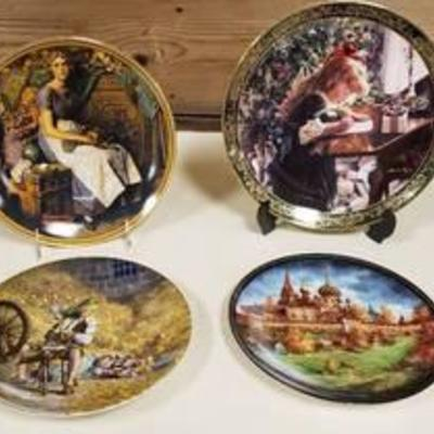 4 Collector Decorator Plates (stands not included) - 1 is Norman Rockwell