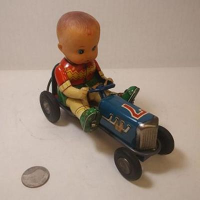 https://www.ebay.com/itm/124181809449BU3037 VINTAGE 1950s TIN PRESSED METAL FRICTION TOY #7 ROADSTER WITH BOY DRIVER MADE IN JAPAN...
