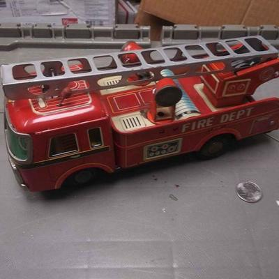 https://www.ebay.com/itm/114217145484BU3007 VINTAGE RED 1960s TOY PRESSED STEEL FIRE TRUCK $20.00 MADE IN JAPAN 10 X 4 1/4 INCHES , 3...