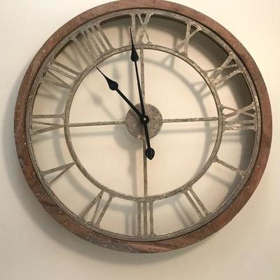 SOLD $65  Over sized round, gold metal wall clock with Roman numeral wrapped in a natural wood frame. Size: 2