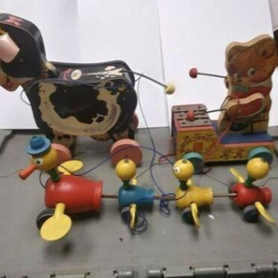 https://www.ebay.com/itm/124190472058BU3034 VINTAGE LOT OF THREE  1950s FISHER PRICE WOOD PULL TOYS 1958 MOO COW #155 Auction