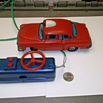https://www.ebay.com/itm/124190475195BU3074 VINTAGE USED TOY  RED 1957 FORD POLICE FRICTION TIN PRESSED METAL CAR BAT Auction