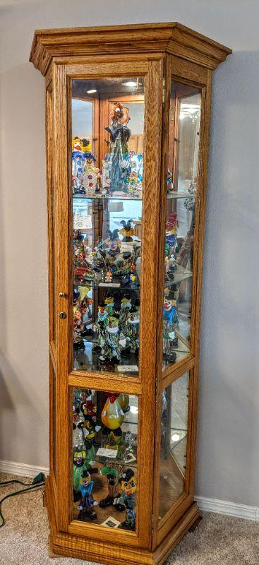 """Oak display cabinet - push light w/lock 13"""" deep  30"""" wide at back 17"""" wide at front  $175.00"""