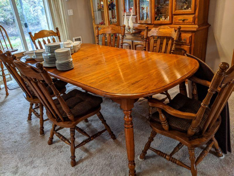 """4-leg oak dining table, very nice quality and condition 6 chairs 2 extension leaves w/pads and tablecloths 42"""" wide 7' with both 11.25"""" leaves in place  $175"""