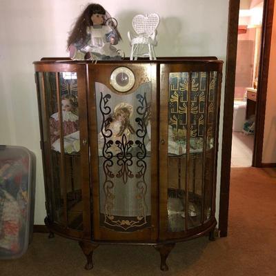 Vintage display cabinet with clock