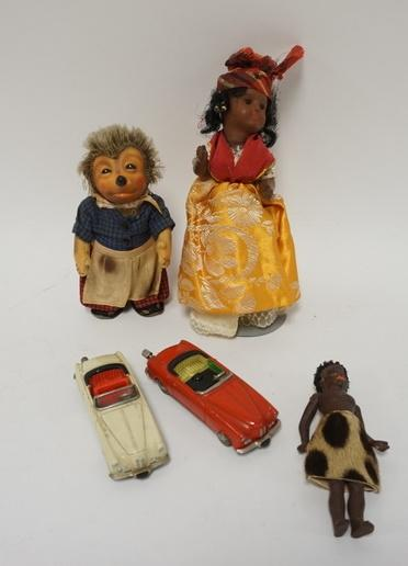 1011	LOT OF VINTAGE DOLLS AND SCHUCO TOY CARS