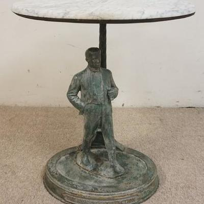 1020	FIGURAL TABLE WITH OVAL MARBLE TOP. METAL FIGURE OF A MAN ON A CAST IRON BASE. 26 IN X 18 1/2 IN, 28 IN HIGH. TOP IS LOOSE