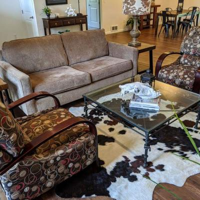 View of sofa, two recliners and coffee table