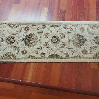Persian style ivory color rug runner.