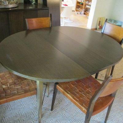 McCobb dining table and 4 chairs. One leather seat strap is broken.