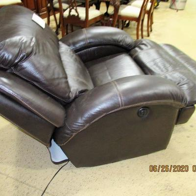 Brown Leather electric operated recliner $300.00/ like new.