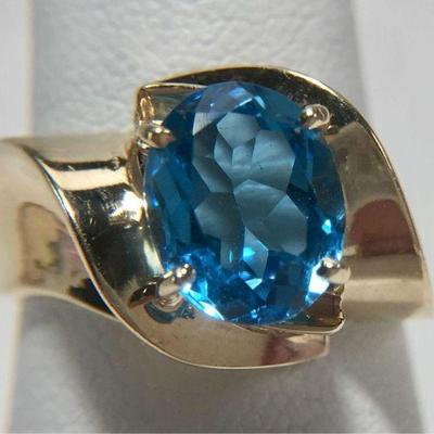 #5: Estate Genuine Gold Ring. Size 7. Intense Blue Topaz Estate Genuine Gold Ring. Size 7. Phenomenal Oval Cut Intense Blue Topaz!...