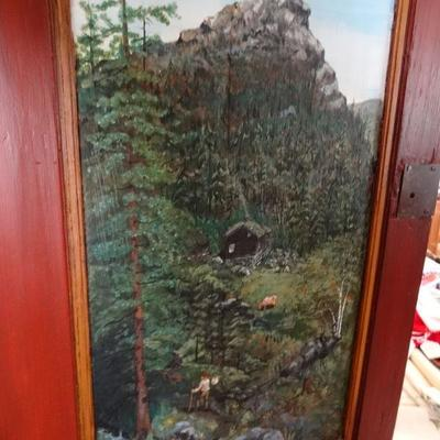 This is the hand painted scene that is inside the door of the corner cabinet.