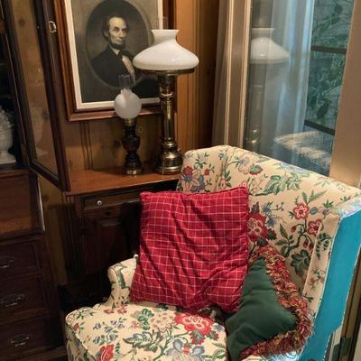 One of a pair of floral wing back chairs.