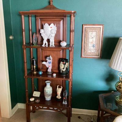 Faux bamboo shelf with Lladro ++.