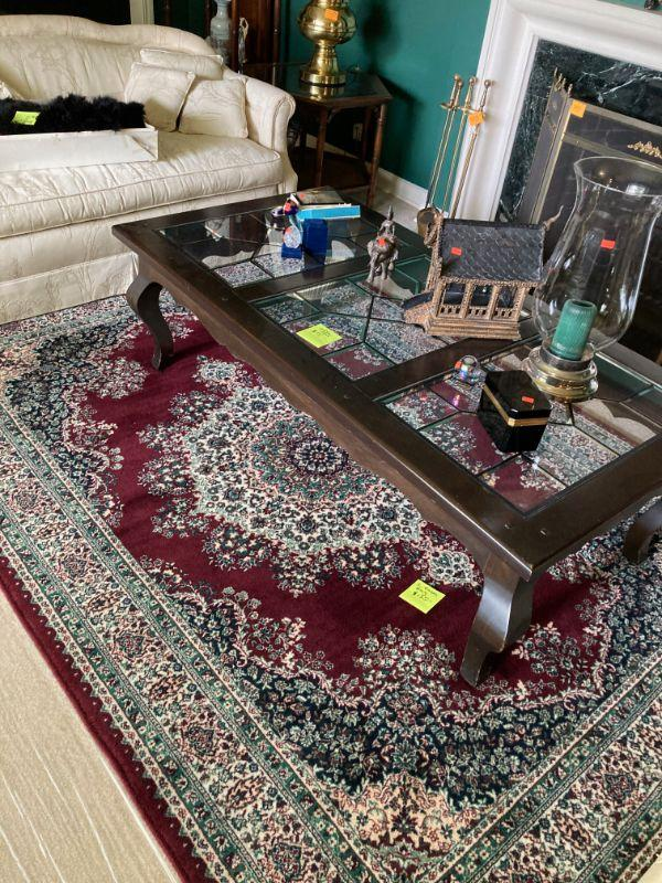 Nice machine made rug and coffee table.