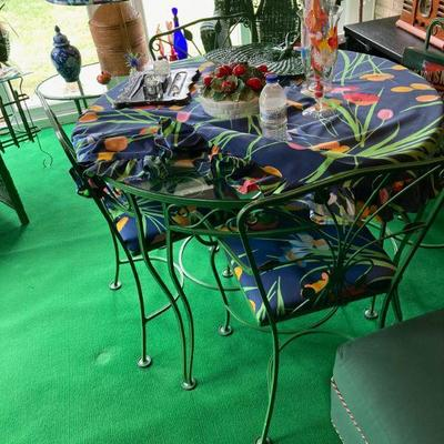 Superior wrought iron table and chairs.