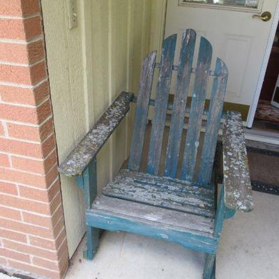 lichen encrusted Adirondack rocking chair