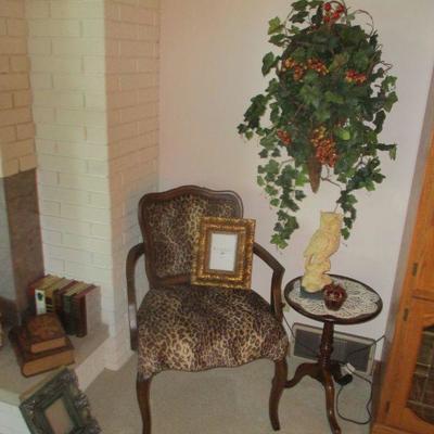 Faux leopard skin arm chair.