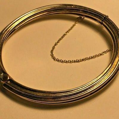 WL114 STERLING SILVER GOLD TONE BRACELET WITH CHAINED CLASPhttps://www.ebay.com/itm/124320686785BIN $20.00