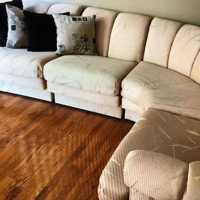 This wrap=around sofa is as good as new like it came from the store yesterday!