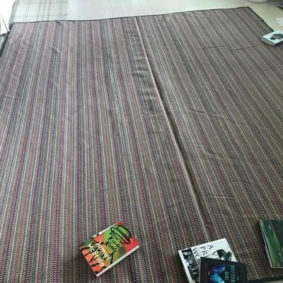 Vibrantly colored woven bound carpet, 8