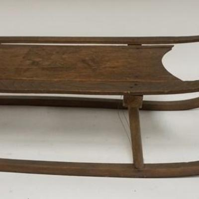 1006ANTIQUE SMALL CHILDS SLED W/LION DESIGN ON MAIN BOARD, 31 IN LONG