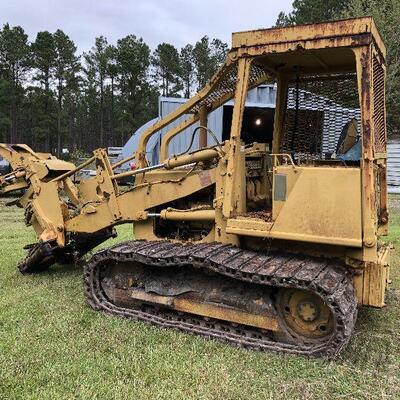 caterpillar feller-buncher. 4 cylinder caterpillar engine, wide tracks, 7,000 hrs. Running. Needs a water pump and one brake repaired....