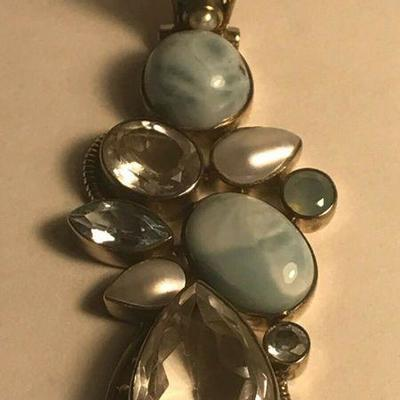 https://www.ebay.com/itm/114403234095	WL140 STERLING SILVER AND LIGHT BLUE TOPAZ CLASP PENDANT	Auction Starts 09/16/2020 After 6 PM
