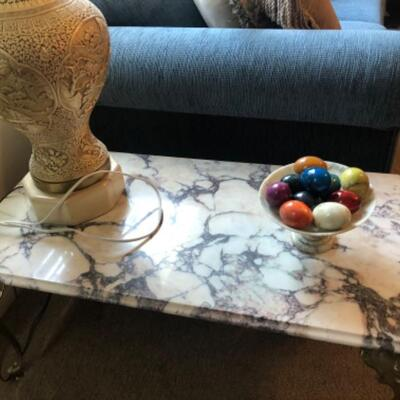 Marble top table and alabaster eggs