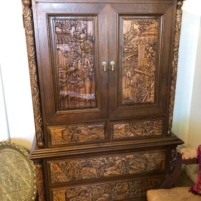 Detailed ha d carved armoire