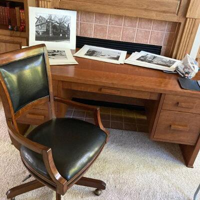 High end cherry desk and top of the line office chair.