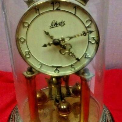 https://www.ebay.com/itm/124377651439LX3030 10 INCH HIGH USED VINTAGE LCHATZ WIND UP BRASS CLOCK WITH GLASS DOME  $23.00  Buy-It-Now