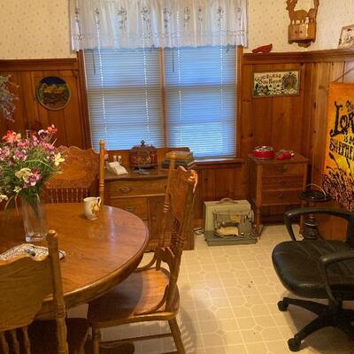 Eating area with oak table & 4 chairs, sewing cabinet & sewimg machine