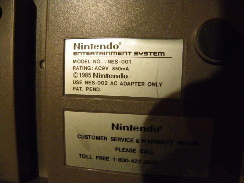 """ Nintendo NES-001 with games""."