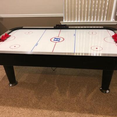 Air Hockey Table, Electric Score Board and 3 period Timer.            2 Pucks and 4 paddles