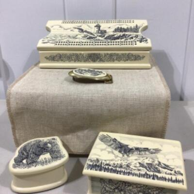 Etched wildlife on decorative boxes