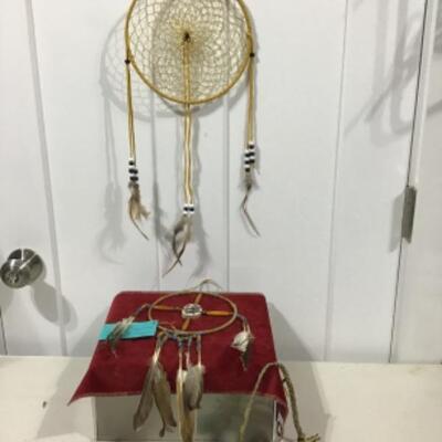 Small ceremonial pipe, dream catcher and medicine wheel